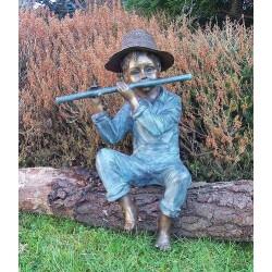 Bronzefiguren - Junge mit Flöte sitzend